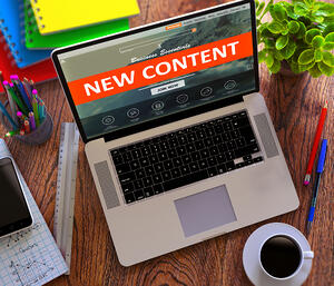 New Content on Laptop Screen. E-commerce Concept.